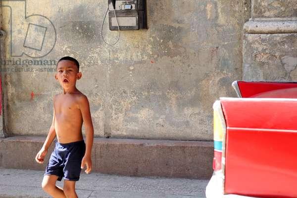 Boy and car, Havana, Cuba (photo)