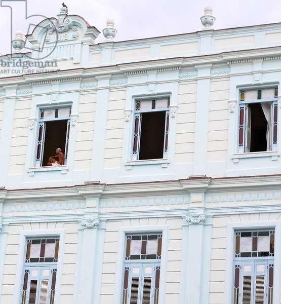 Man in a window, Havana, Cuba (photo)
