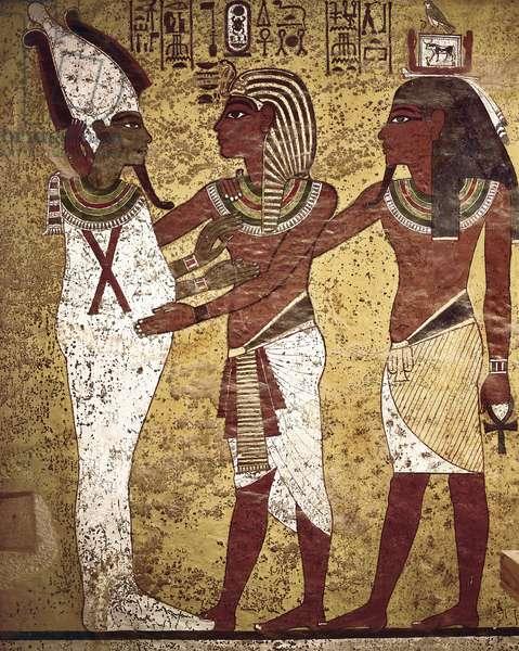 Egyptian Antiquity: the pharaoh Tutankamun facing the god Osiris