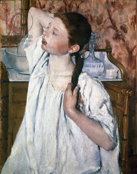 Girl styling her hair. Painting by Mary Cassatt (1845-1926), 1886. Oil on canvas. Washington, National Gallery of Art.