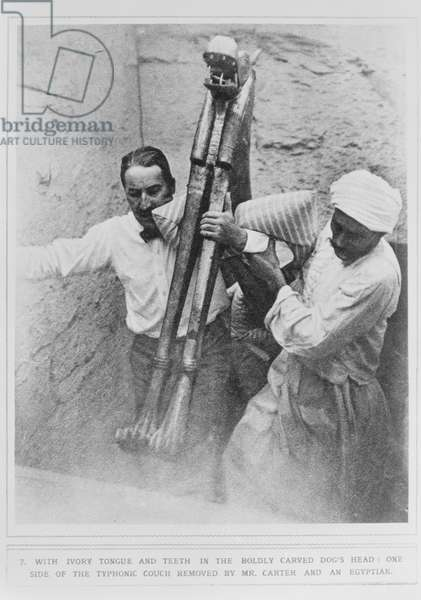 Howard Carter (1873-1939) and an Egyptian removing the typhonic couch from the Tomb of Tutankhamun (b/w photo)