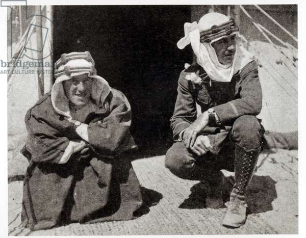 T. E. Lawrence and Mr L. Thomas outside their tent, 1919 (b/w photo)