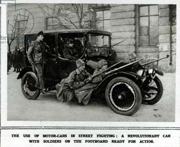 The use of motor-cars in street fighting: A Revolutionary car with soldiers on the footboard ready for action, 1917 (b/w photo)