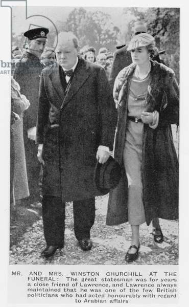 Sir Winston Churchill (1874-1965) and his wife, Clementine Ogilvy, at the funeral of T. E Lawrence (1888-1935) 1935 (b/w photo)
