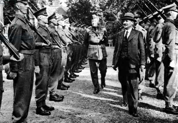 Britain's New Prime Minister at the Berlin Conference: Mr. Attlee Inspecting a Guard of Honour of the Scots Guards at his Potsdam Residence, from 'The Illustrated London News', 4th August 1945 (b&w photo)