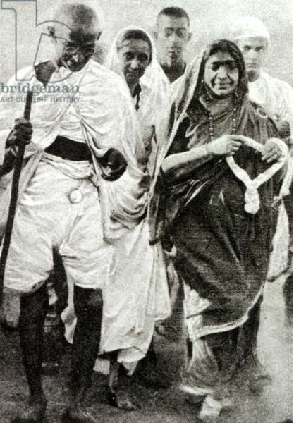 On his way to break the Salt Laws - Gandhi with Mrs. Sarojini Maidu at Dandi, from 'The Illustrated London News', 3rd May 1930 (b&w photo)