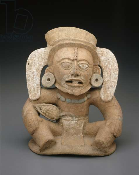 Figure from a vessel top in the form of a cocoa (chocolate) deity, 600-900 AD (slipped & painted earthenware)