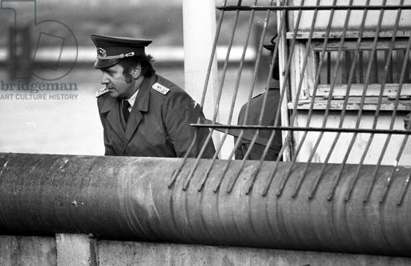 German reunification, Fall of the Berlin Wall, Germany, 1989: police officer. Photography