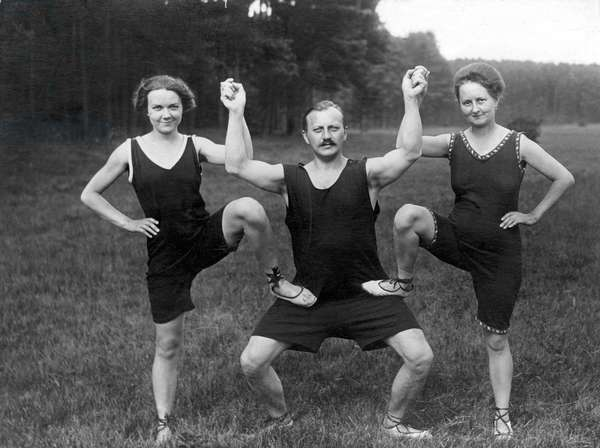 Sport, Gymnastics: Man with two women in sports tracksuit. photography around 1917