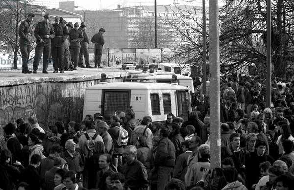 German Reunification, Fall of the Berlin Wall, Germany, 1989: police van parking along the wall. Photography
