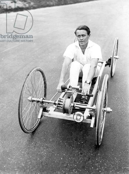 Sport: Man driving a strange bicylette. Photography around 1929