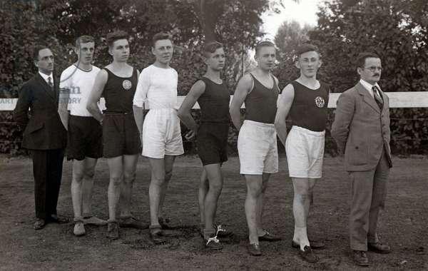 Sport: Athlete in sportswear with a coach.
