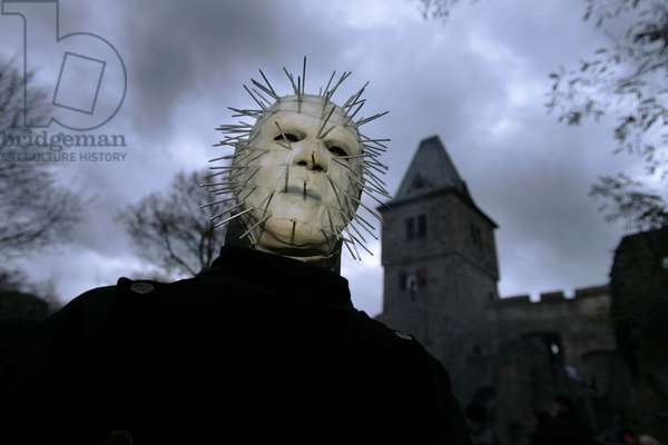 Monster mask at the Halloween party. Photography At Halloween a monster in the castle Frankenstein, Hessen, Germany