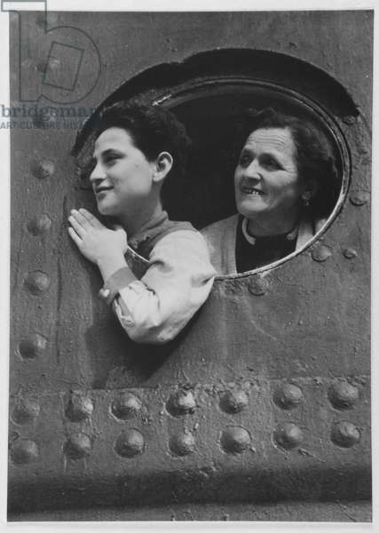 Grandmother and grandchild on their way to the homeland, 1950s (b/w photo)