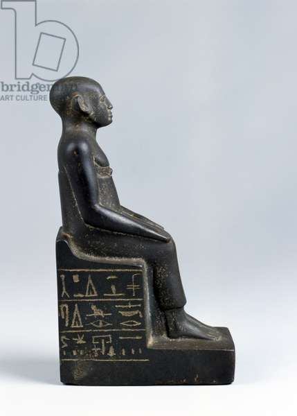 Statuette of the vizier's scribe Montuhotep, seated on a funerary chair with a conventional funerary formula (basalt)