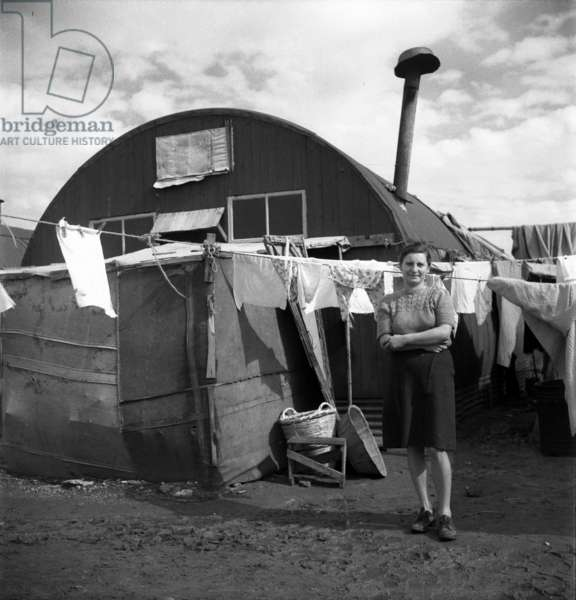 Woman by a refugee shack, Cyprus, 1949 (b/w photo)
