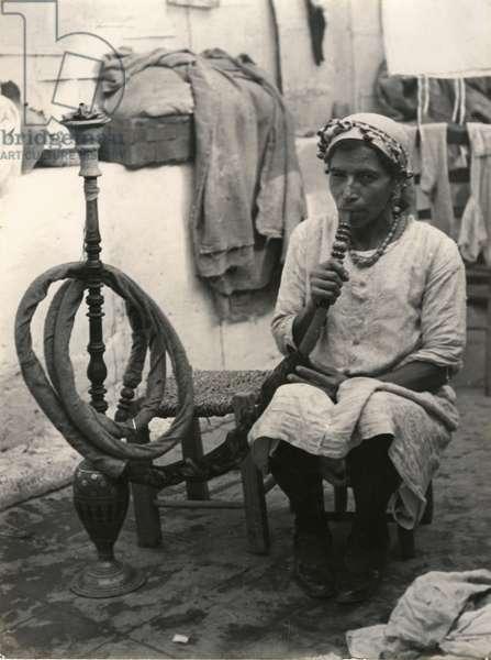 Yemenite Jewess Smoking A Nargileh, She'arayyim, 1937 (b/w photo)