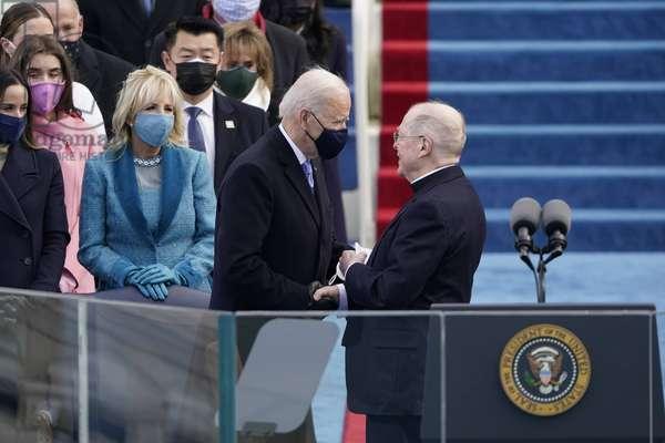 President-elect Joe Biden speaks with Father Leo ODonovan (photo, 2021)