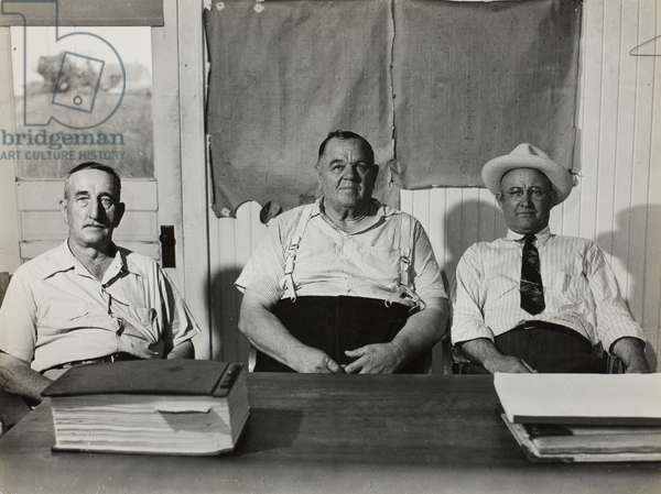 F.C. Nelson, Commissioner, Cecil Faris, Mayor, and H.W. Coleman, Commissioner, Town Hall, Tomball, Texas, May 1945 (gelatin silver print)