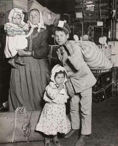 Italian Family Seeking Lost Baggage, Ellis Island, 1905 (gelatin silver print)