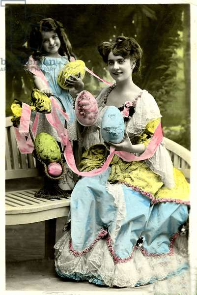 Woman and child holding Easter eggs.