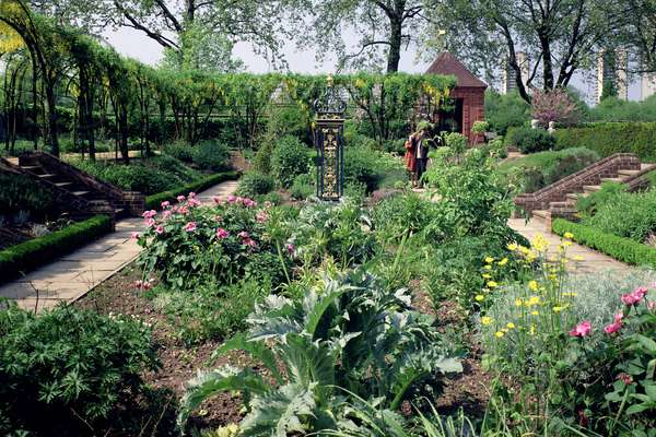 The sunken herb garden, begun in 1964 (photo)