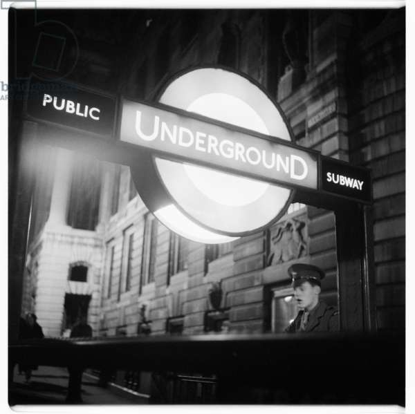 London at Night, Trafalgar Square tube, image from a night walk round central London, showing the tube entrance by South Africa House, Trafalgar Square, London 1957