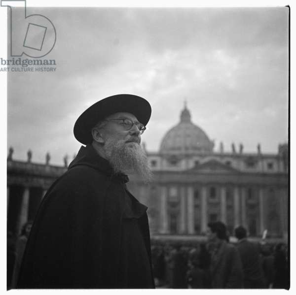 Portrait of a wispy bearded prioest against a sunbeam sky, St.Peters Square, Rome early early 1950's