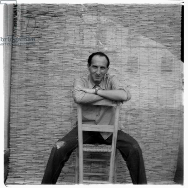 Eugenio Carmi, in his studio, possibly Rome Italy, mid 1960' (b/w photo)