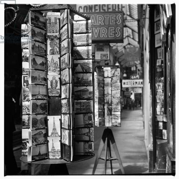 Postcard rack in Paris, c.1955 (b/w photo)