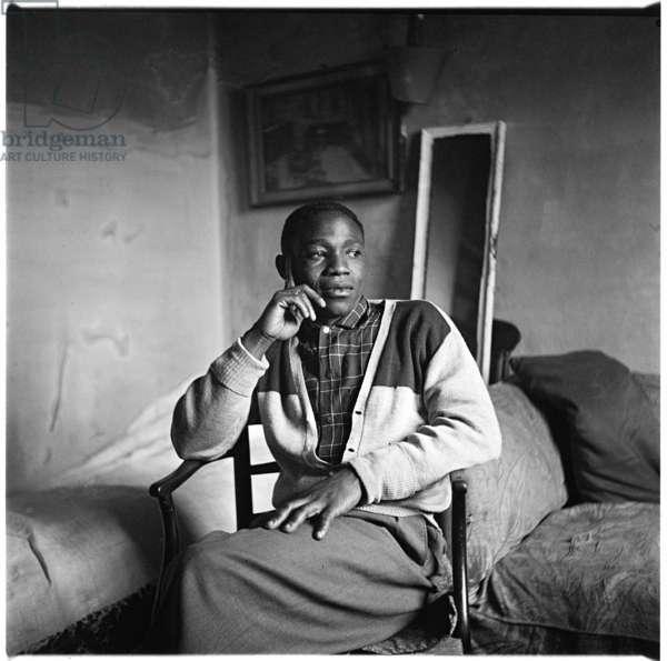 Black Man, portrait of friend, possibly boyfriend of writer Colin McInnes in his home, London, UK, 1950's (b/w photo)