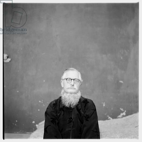 Sir William (Bill) Epson, portrait of leading literary critic, poet & professor of English literature in a Chinese jacket, Soho, London, UK, 1955 (b/w photo)