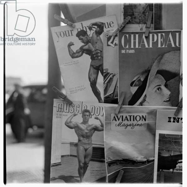 Image of a magazine stand showing early gay interest magazines, possibly Rome, wearly early 1950's