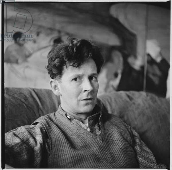 Michael Andrews, portrait of the artist Michael Andrews in his studio painting John Deakin, Soho, London, UK, c.1963 (b/w photo)