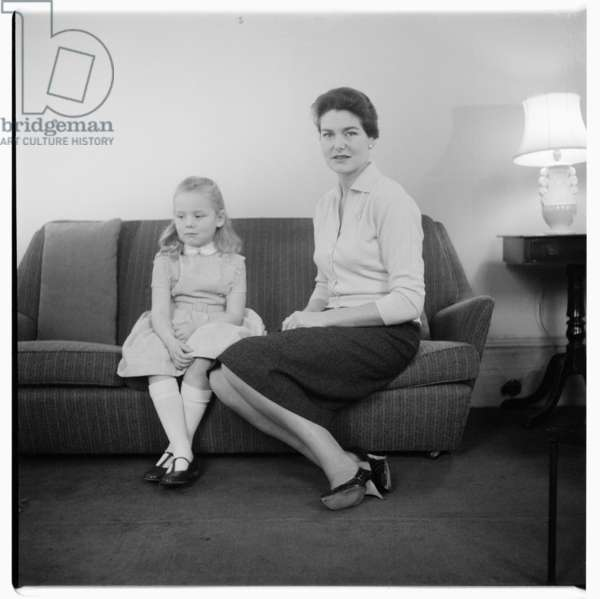 Mrs Colvin and her daughter at home in London, c.1955 (b/w photo)