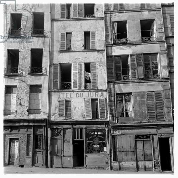 Image of Hotel du Jura, since moved, alongside dilapidated buildings, Paris, early early 1950's