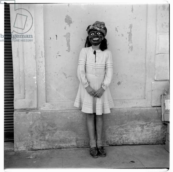 Portrait section of unknown masked girl, perhaps a performer, Paris, early early 1950's