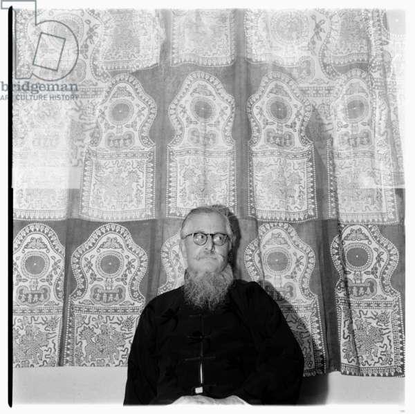 Sir William (Bill) Epson, portrait of leading literary critic, poet & professor of English literature in a Chinese jacket, Soho, London, UK, 1956 (b/w photo)