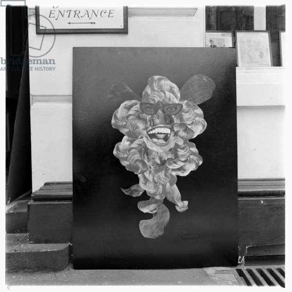 "Image of lost original collage artwork titled ""Portrait of Peter Ustinov"" by John Deakin, outside Museum Street Gallery Holborn, London, 1962"