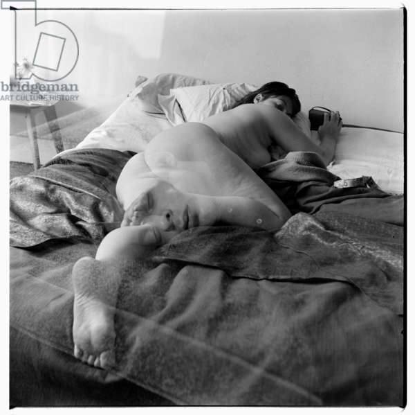 Henrietta Moraes, portrait of model and muse Henrietta Moraes lying naked on bed, used by Francis Bacon for painting 1963, Soho London late 1950's (b/w photo)