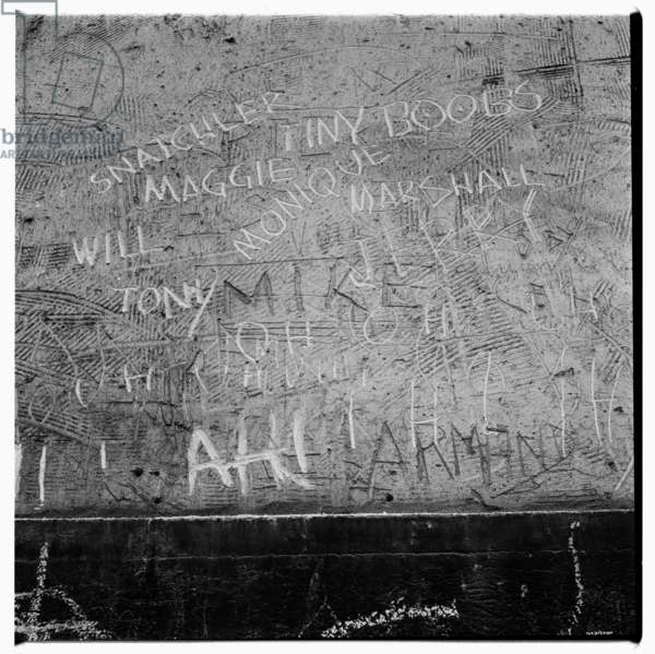 "Image of graffiti in wet cement including English ""tiny boobs"", Paris early early 1950's"