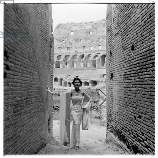 Image from a fashion shoot inside the Coloseum of Paris Collections for French newspaper Le Figaro, 1952, Rome, Italy