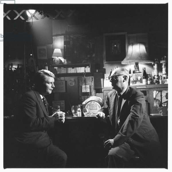 David Archer & Dan Farson, portrait of book publisher and bookshop owner, partner of John Deakin being interviewed by Dan Farson in in a Soho pub, London early 1960's (b/w photo)