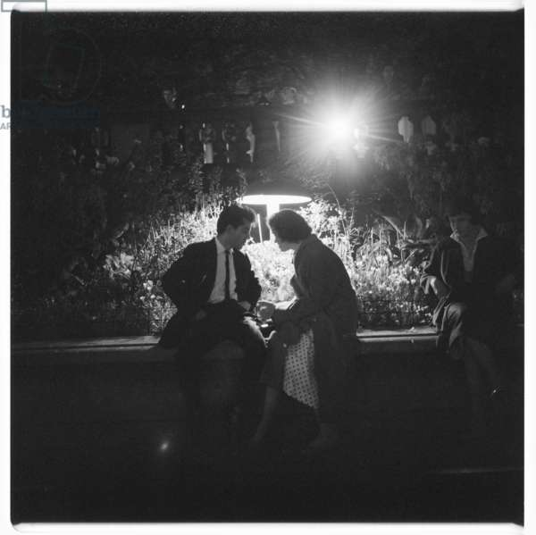 London at Night, Trafalgar Square lovers, image from a night walk round central London, showing lovers sat in Trafalgar Square, London 1957