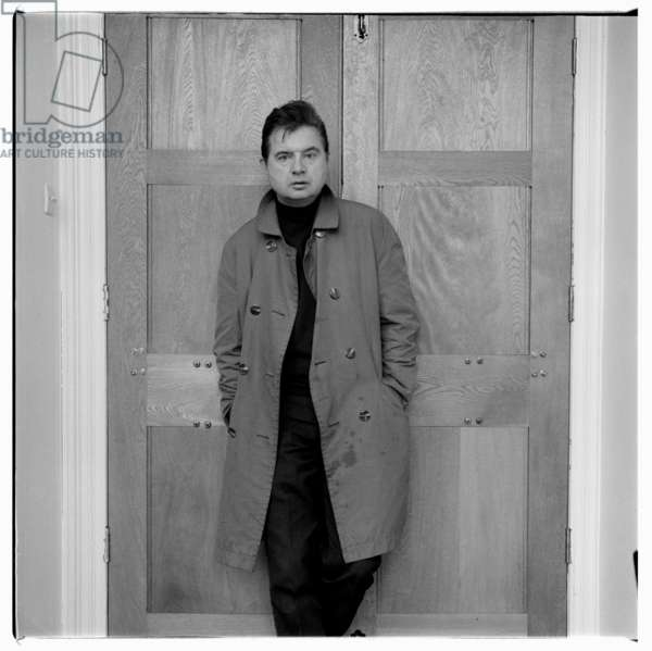 Portrait of the artist Francis Bacon wearing polo neck and mac, London, early 1960's (b/w photo)