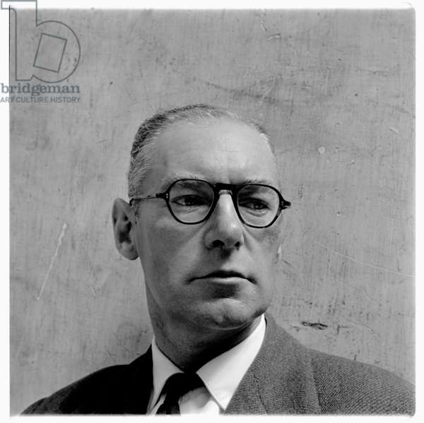 David Archer, portrait of David Archer, book publisher at Parton Press, and bookshop owner on Greek Street Soho London in late 1950's (b/w photo)