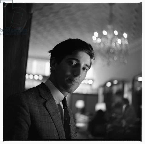 Gucci store London, portrait of a shop assistant inside a Gucci shop, London, UK, early 1960's (b/w photo)
