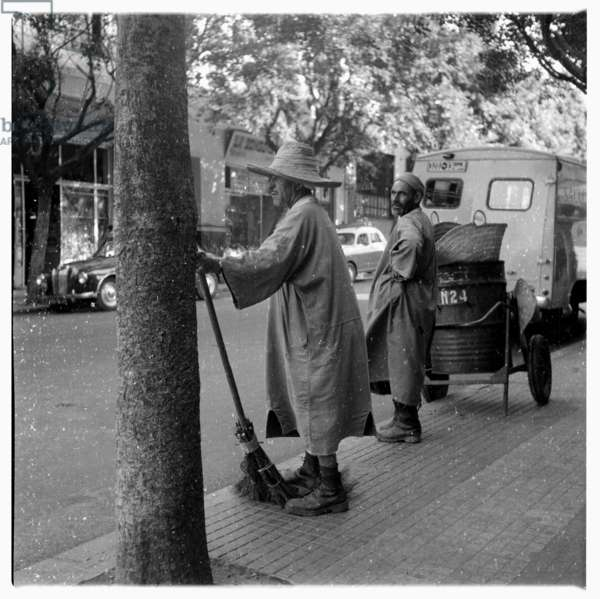 Old man with straw broom in hand, Tangier, early 1960's (b/w photo)