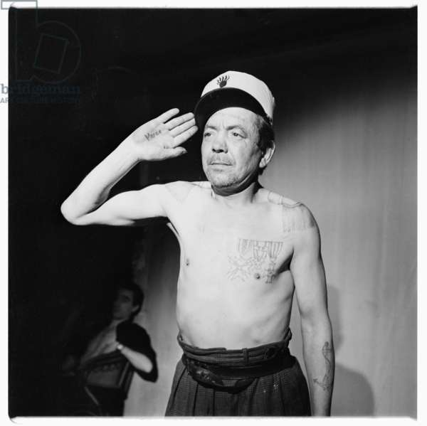 Leon la lune and friends, portrait of Leon la lune, clochard and down-and-out, hero of eponymous documentary and photographed by Robert Doisneau, showing his military tattoos, Paris, France early 1950's