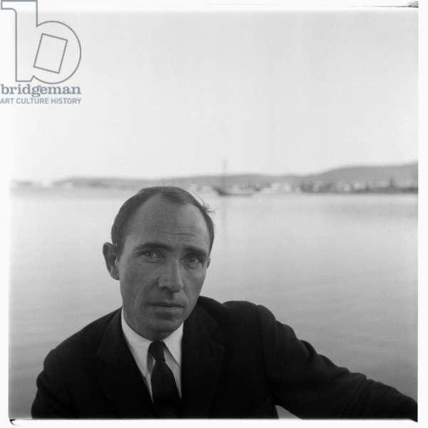 Greece, portrait of unknown Greek man near sea in Greece, mid 1950's (b/w photo)